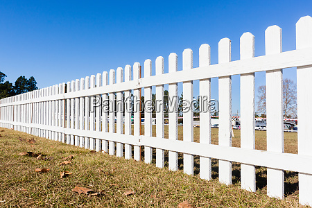 boundary white wood fence grass field