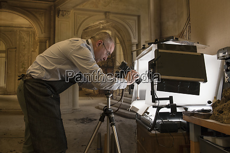 artisan goldsmith taking pictures of a