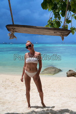 woman over beautiful tropical island background