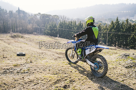 motocross driver at circuit start