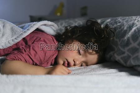 portrait of dreaming little girl