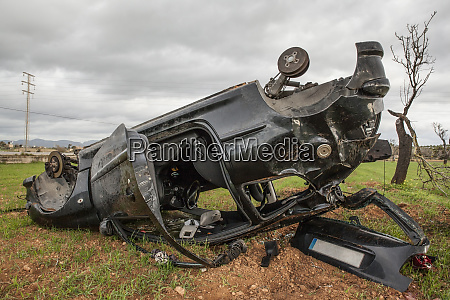 spain mallorca car wreck lying upside