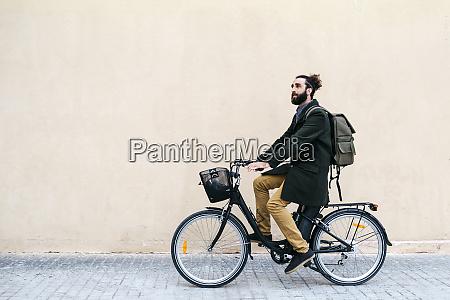 man riding e bike along a