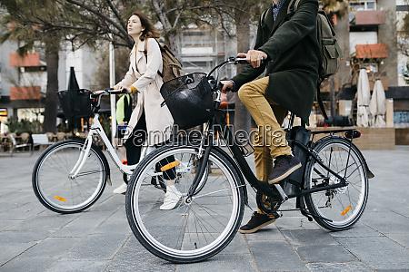 couple riding e bikes in the
