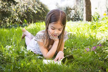 girl lying on meadow