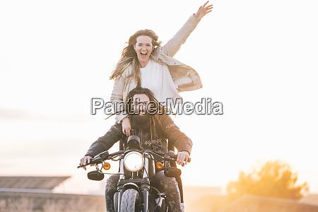 portrait of happy couple on motorbike
