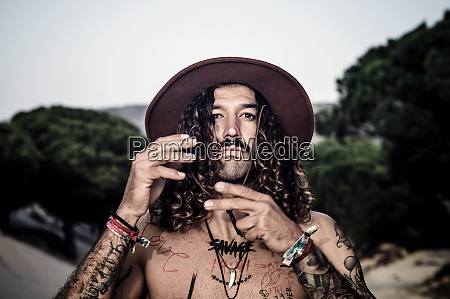 young man with hat tattoos and