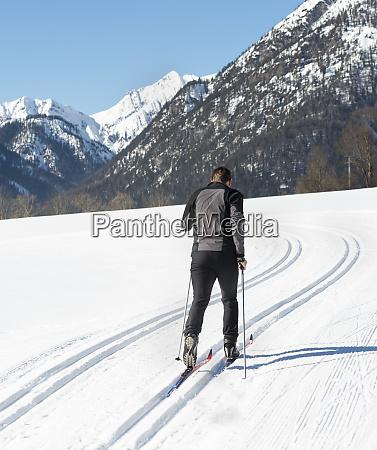 austria tyrol achensee man doing cross