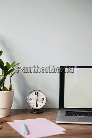 desk with retro clock at home