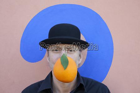 portrait of man with an orange
