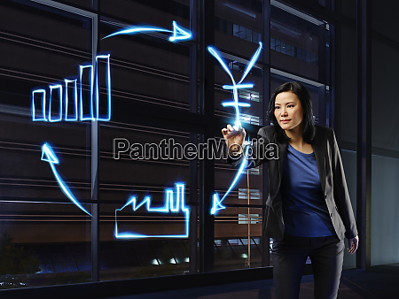 businesswoman painting economic circulation with light