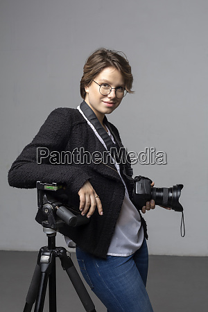 portrait of smiling young photographer with