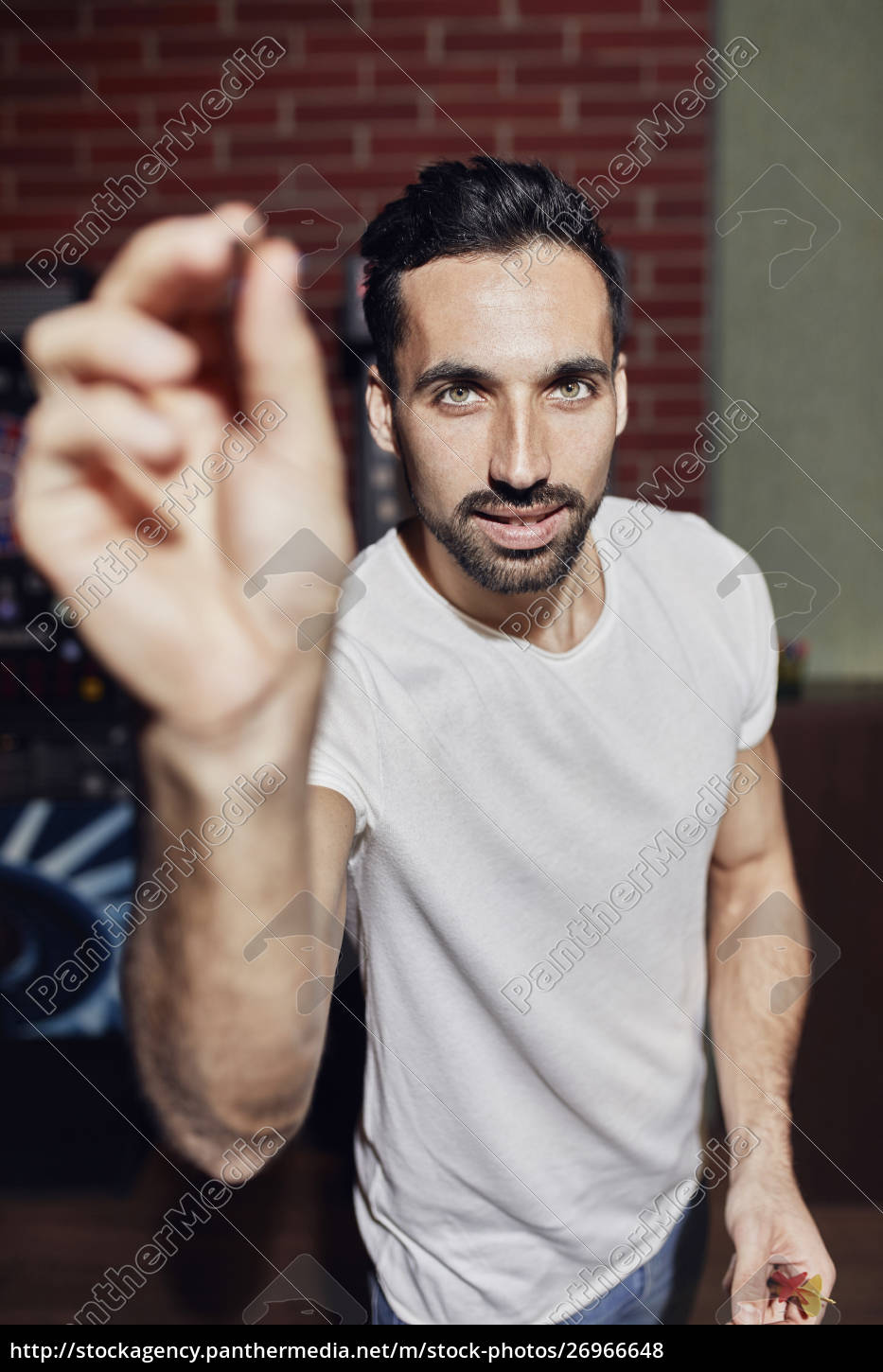 portrait, of, man, playing, darts - 26966648