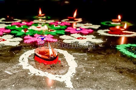 happy diwali diya oil lamps in