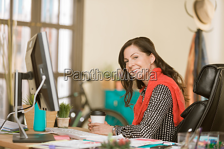 confident woman in a creative office