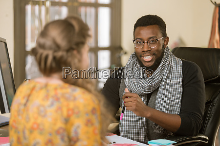 african american man with colleague or