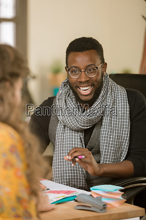 african american man laughing with colleague