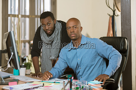 skeptical or angry business men at