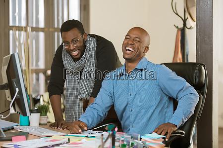 laughing business men at work