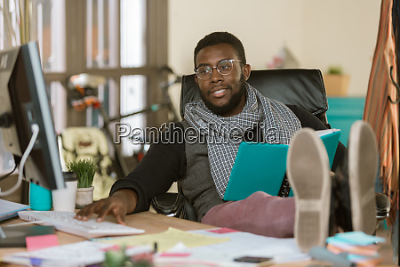 handsome creative business man with feet