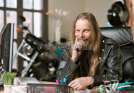 happy man at his desk with