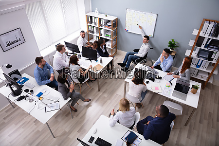 disabled young businessman giving presentation to