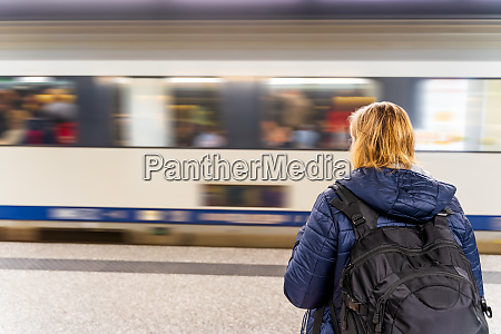 woman waiting for a train in