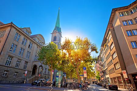 colorful street of zurich sun haze