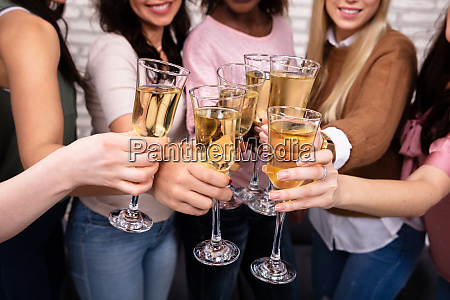 women celebrating a bachelorette party toasting