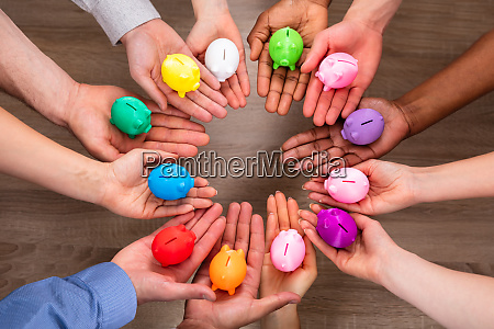 group of peoples hand holding colorful