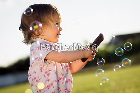 baby girl using phone