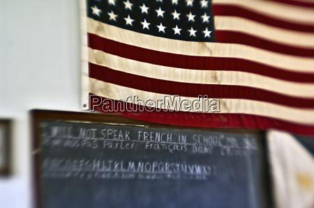 old fashion classroom chalkboard and flag