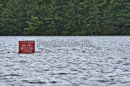 warning sign in a lake