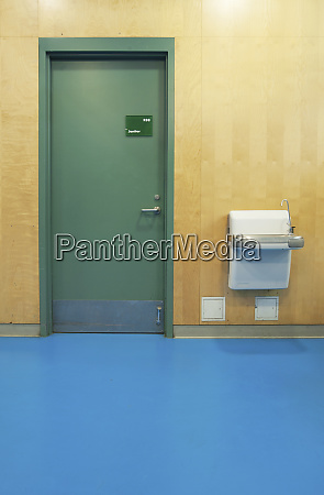 janitorial closet and drinking fountain