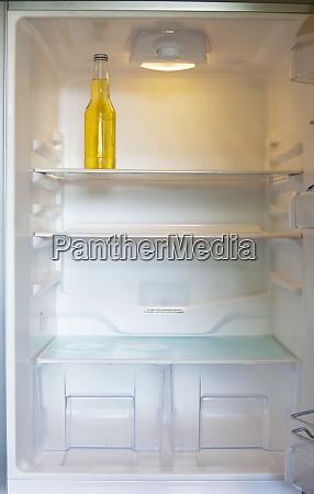 bottle in a refrigerator