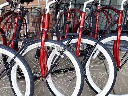 identical red bikes