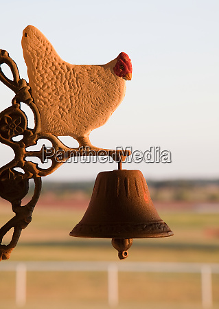decorative bell with chicken figure