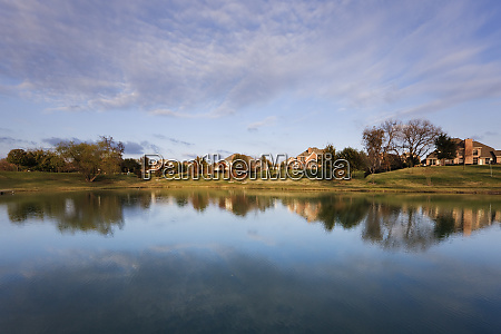 houses reflected in pond