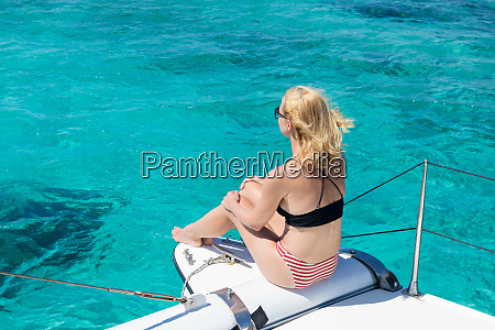 woman relaxing on a summer sailing