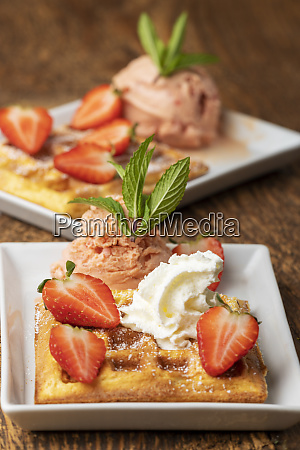 belgian waffle with strawberries on white