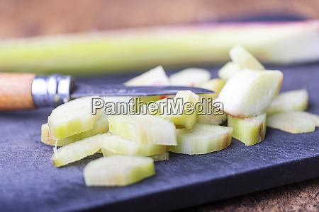 cut rhubarb on a cutting board