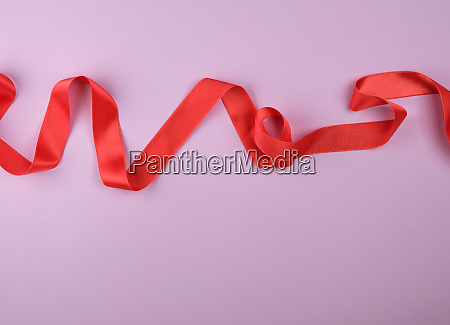 curled red satin ribbon on a