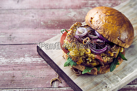 delicious trendy mealworm burger on crusty