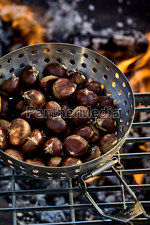 fresh sweet chestnuts in the shells