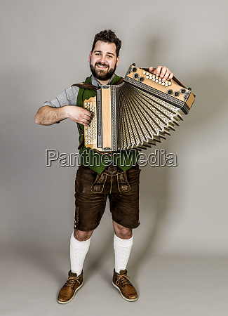 cool young musician with black beard