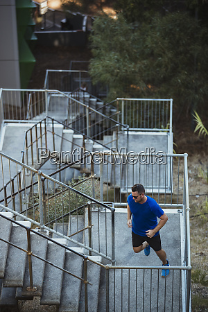 running up outdoor staircase