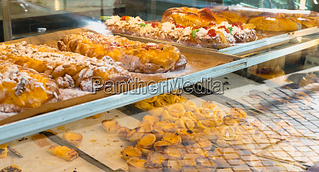 succulent portuguese pastries displayed in porto