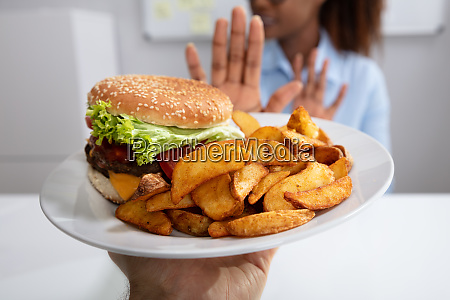 woman refusing unhealthy food