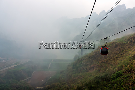 cable way vanishing in mist or