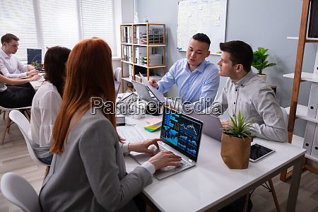 businessman and businesswoman discussing together in